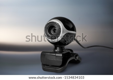 Black computer webcam staying on abstract background Royalty-Free Stock Photo #1534834103