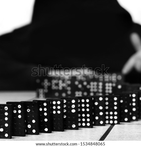 Guy and dominoes. Domino game #1534848065