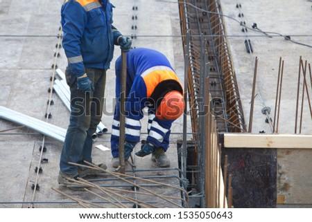 Belarus, Minsk,2015. Team workers construction site building architecture #1535050643