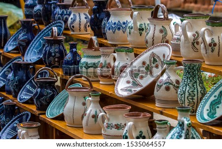 Hand made ceramic pottery. Hand painted pottery. Traditional pottery fair. Cucuteni ceramic pottery. Hand painted ceramics. Romanian ceramic market #1535064557