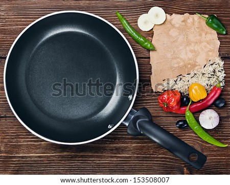 rice with vegetables next to a frying pan and paper for recipe #153508007
