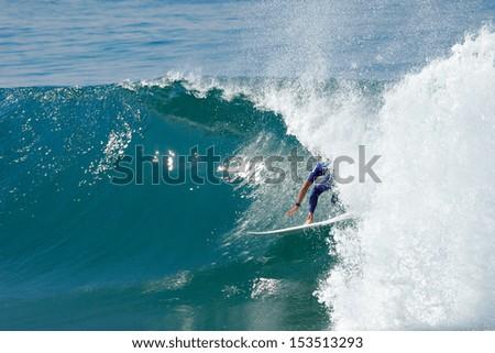 A surfer rides a tube. #153513293