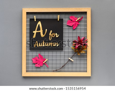 "Photo grid board with purple paper Autumn leaves, a flower and paper text ""A for Autumn"". Fall paper craft concept for interior design or creative ideas for home decoration."
