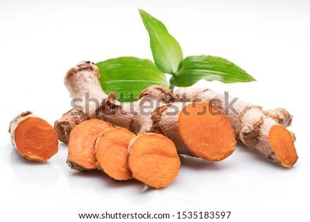 Fresh turmeric rhizome and turmeric cuts isolated on white background. #1535183597