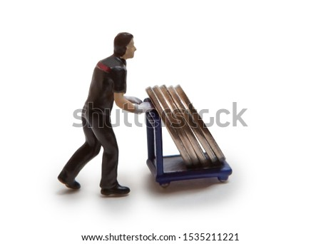 Man-doll carries coins on a cart, isolated on a white background. #1535211221