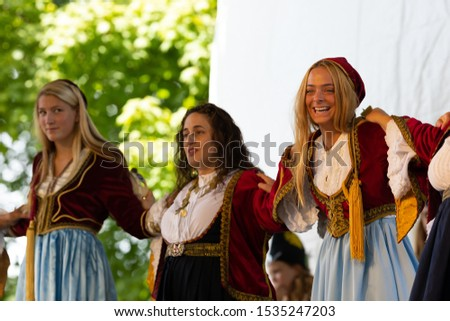 St. Louis, Missouri, USA - August 24, 2019: Festival of Nations, Tower Grove Park, Members of the St. Nicholas Greek Dancers, wearing traditional clothing, performing traditional Greek dances #1535247203