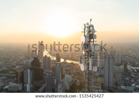 Telecommunication tower with 5G cellular network antenna on city background Royalty-Free Stock Photo #1535425427