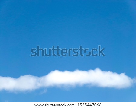 Beautiful blue sky with a smooth strip of cumulus clouds.Background and blank for different purposes.Insert letters. #1535447066
