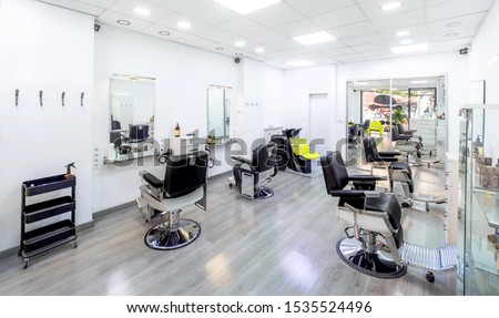 Modern bright hair and beauty salon. Barber salon interior business with black and white luxury decor. #1535524496
