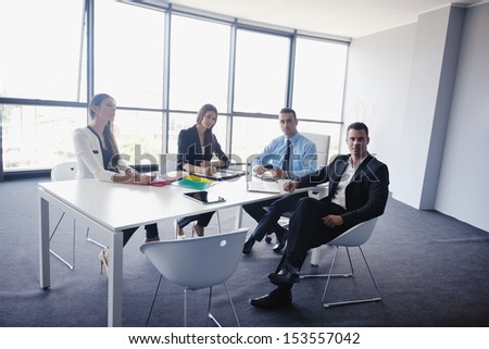 Group of happy young  business people in a meeting at office #153557042
