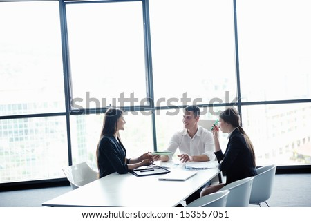 Group of happy young  business people in a meeting at office #153557051