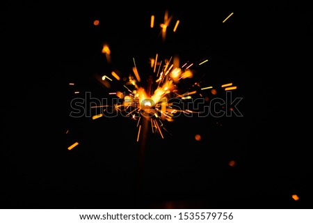 Sparks in the dark. Sparks. Christmas and New Year time. Magic light #1535579756