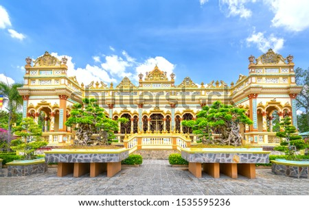 View from the front of the Vinh Trang temple in My Tho, Vietnam with patterns of 19th century culture in southern Vietnam Royalty-Free Stock Photo #1535595236