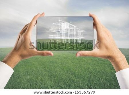 Architect showing new house project with tablet #153567299