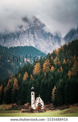 Autumn landscape in the Dolomites Alps, Trentino Alto Adige, Italy. Santa Maddalena church