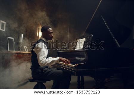 Black grand piano player, jazz performance