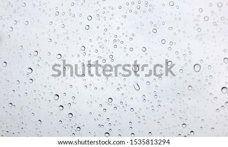 Water rain drops on glass background. Rain drops on a Windows. #1535813294