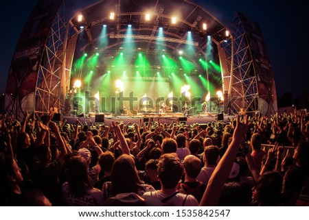 MADRID - JUN 30: The crowd in a concert at Download (heavy metal music festival) on June 30, 2019 in Madrid, Spain. #1535842547