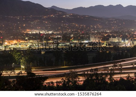 Twilight morning cityscape view of Glendale buildings, neighborhoods and freeways near Los Angeles and Burbank in Southern California. #1535876264