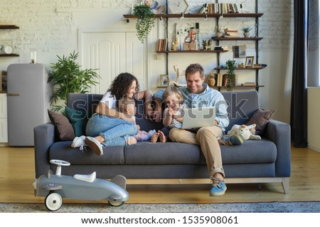 Young beautiful happy family relaxing at home #1535908061