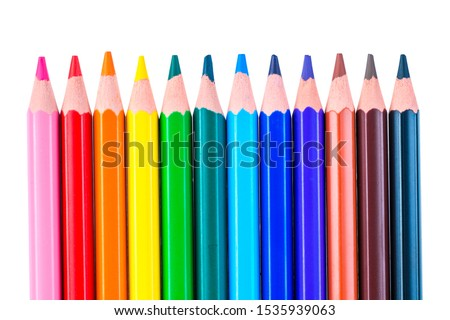 a row of colored pencils sharpened sharply on a white background isolated #1535939063