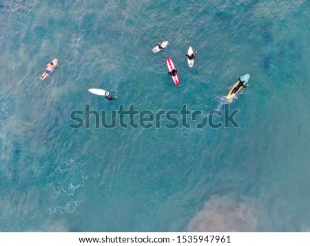 Aerial top view of surfers waiting the waves in blue water. Del Mar Beach, California, USA. October, 11th, 2019 #1535947961
