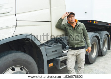 truck driver stands beside the semi-trailer truck, freight industry truck transport. #1536078803