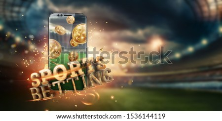 Gold inscription Sports Betting on a smartphone on the background of the stadium. Bets, sports betting, bookmaker. Mixed media. Royalty-Free Stock Photo #1536144119