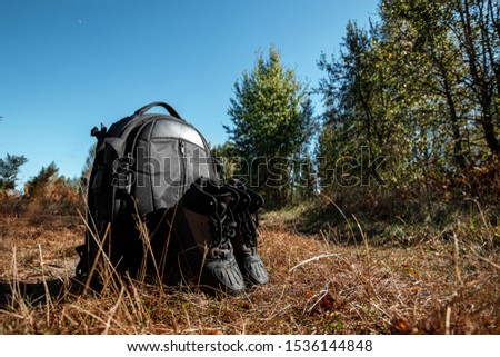 Camping backpack and boots on a background of summer nature. Trekking and camping adventures, hiking, hiking, traveling #1536144848