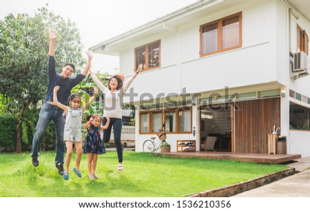 Portrait Asian family front of house, happy family home concept #1536210356