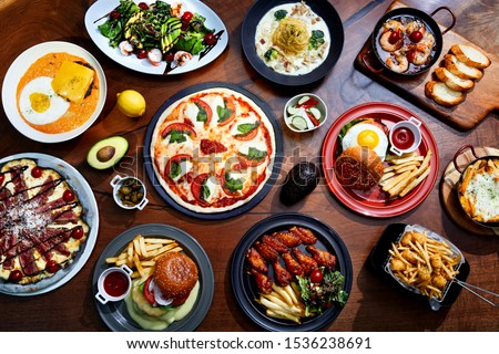 a collection of various foods on a wooden board. #1536238691