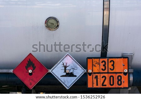 Labels and plates with danger number in a tank truck,mandatory in the transport of dangerous goods. #1536252926