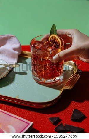 Negroni cocktail, an aperitif cocktail with a typical light red color, based on vermouth, bitters and gin. It is an officially recognized cocktail and one of the most famous #1536277889