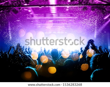 Concert spectators in front of a bright stage with live music #1536283268