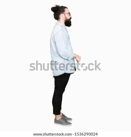 Young hipster man with long hair and beard wearing glasses looking to side, relax profile pose with natural face with confident smile. #1536290024
