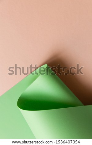 Muted colors curved paper abstract geometrical background. Creatively shaped curves fashiom concept. Light green, neo mint, pastel pink.  #1536407354