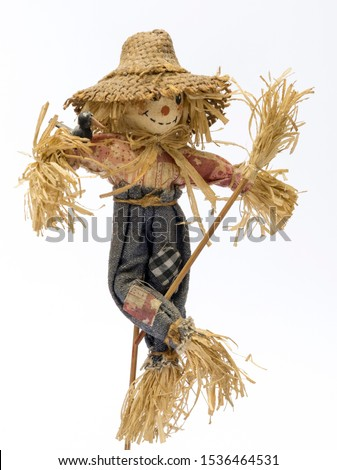 Scarecrow doll on white background