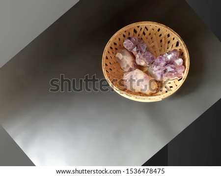 amethyst crystals heals. Four crystals in a cane bowl. Crystal therapy  balances physical ailments of the nervous system,  powerful love energy in the environment when placed in clusters in a room. #1536478475