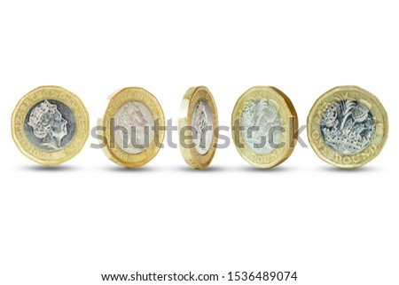 Closeup of Isolated of One Pound sterling coins standing on white background. #1536489074