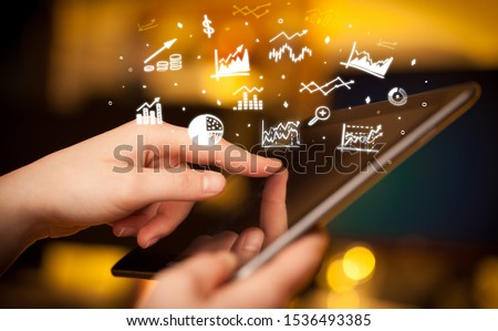 Hand holding tablet with online business report concept #1536493385
