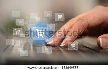 Business woman hand typing on keyboard with online shopping concept #1536495554