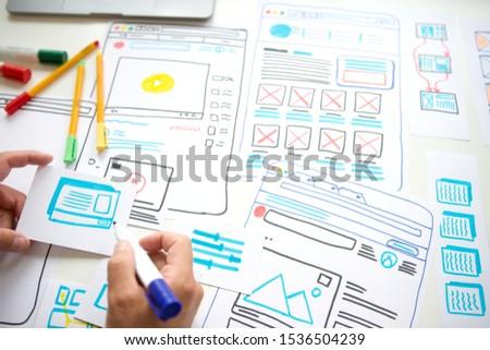 Website designer Creative planning application development draft sketch drawing template layout framework wireframe design studio . User experience concept . - Image
