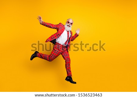 Full length photo of funny hipster grandpa white beard guy jumping high exciting trip wear plaid red blazer tie trousers outfit isolated yellow bright color background #1536523463