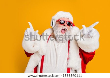 Nightclub invite on christmas party celebration funky crazy santa claus dj in white headset sing song sound melody listen music dance wear stylish x-mas hat suspenders isolated yellow color background #1536590111