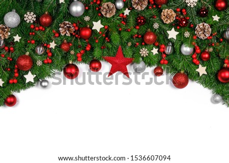 Christmas Border frame of tree branches on white background with copy space isolated, red and golden decor, berries, stars, cones #1536607094