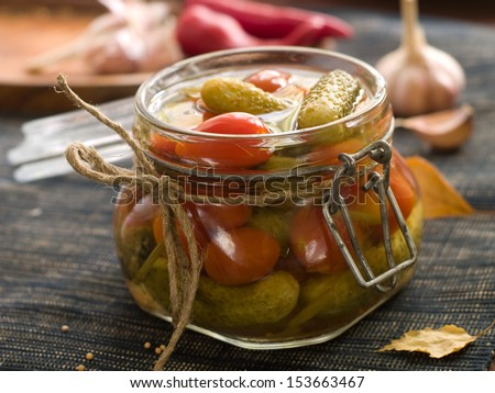 Preserved cucumber and tomato in glass jar, selective focus #153663467