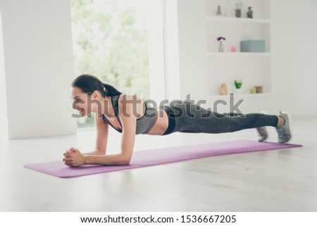 Full length body size photo of cheerful positive pretty charming girlfriend standing in plank smiling toothily in sneakers focused Royalty-Free Stock Photo #1536667205