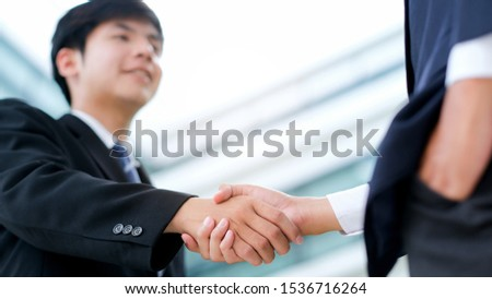 Businessmans handshake. Successful businessmen handshaking after good deal. Business partnership meeting concept. #1536716264