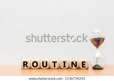 Hourglass and daily routine word block wood on desk wooden white background.   #1536734243
