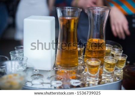 Alcohol in many large bottles and small glasses #1536739025